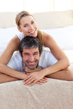 Enamored couple lying on the bed Royalty Free Stock Photo
