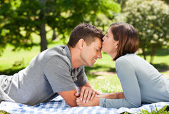 Enamored couple in the park. Laying on the grass stock images