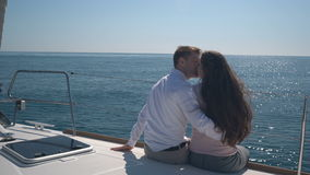 Enamored couple sitting on a yacht. On a sunny day stock video