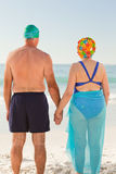 Enamored elderly couple at the beach Stock Photography
