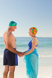 Enamored elderly couple at the beach Stock Image