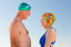 Enamored elderly couple at the beach Stock Images