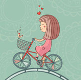 Enamored girl on bicycle Stock Photo