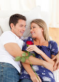 Enamored lovers relaxing on sofa. At home royalty free stock image