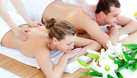 Enamored young couple enjoying a back massage Royalty Free Stock Photo