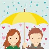 Enamouré sous un umbrellla Photo stock