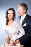 Enamoured bride and groom Stock Image