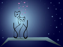 Enamoured cats against dark blue night sky. Enamoured cats on a background of dark blue night sky, hand drawing cartoon vector illustration Royalty Free Stock Photo