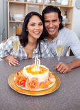 Enamoured couple celebrating Royalty Free Stock Photos