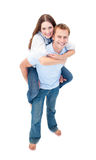 Enamoured couple enjoying piggyback ride Royalty Free Stock Photography