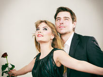 Enamoured couple in titanic gesture. Stock Photos