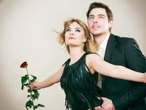 Enamoured couple in titanic gesture. Stock Photo