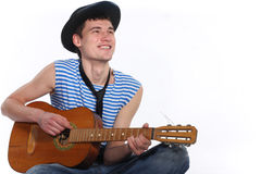 Enamoured guitarist. Cheerful boy with guitar isolated on white background Royalty Free Stock Photography