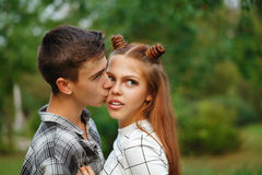 Enamoured kiss teens. Enamoured teens kiss passionately. Girlfriend and boyfriend together. Close-up. First love. He falls in love. Date Royalty Free Stock Photos