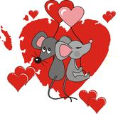 Enamoured mice. Two enamoured mice sitting on red heart Stock Photo