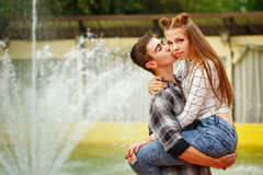 Enamoured teenagers hugged strongly and kiss. Stock Image
