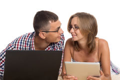 Enamoured Young Man And Woman With A PC Stock Photography