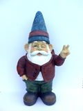 Enano divertido con una chaqueta roja y un sombrero azul Imagen de archivo libre de regalías
