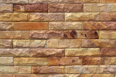 Enarene la superficie de la pared de piedra, fondo de adornan Foto de archivo