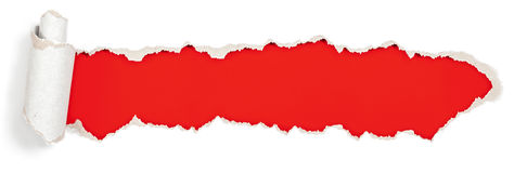 Encabeçamento vermelho no furo de papel rasgado foto de stock