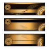 Encabeçamentos dourados ajustados na escolha três Fotografia de Stock