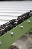 Encadenamiento del transportador de rodillo - DOF bajo Fotografía de archivo libre de regalías