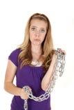 Encadenamiento triste de la muchacha Foto de archivo libre de regalías
