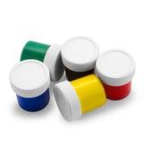 Encaisse les bouteilles polychromes de peinture à l'huile dessus Photographie stock libre de droits