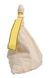 Encaissez le sac avec un label jaune, pièces de monnaie remplies Image stock
