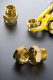 Encaixes de bronze com chave imagens de stock royalty free