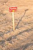 Encanamento do sinal na terra da construção Fotografia de Stock Royalty Free