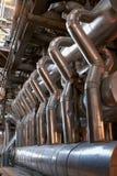 Encanamentos e escadas na central energética Fotografia de Stock Royalty Free