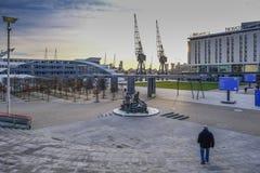 Encante el área con la escultura de estibadores en el Londres Excel Exhi imagen de archivo libre de regalías