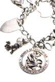 Encanto antigo da medalha do St. christopher no bracelete Foto de Stock