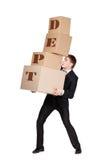 Encargado que da la pila de cajas para el departamento Foto de archivo