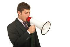 Encargado que habla hacia fuera por el megáfono Imagen de archivo libre de regalías