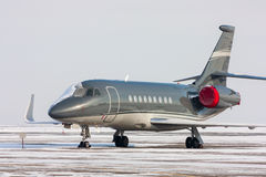 Encased private jet. In a cold winter airport Royalty Free Stock Photography