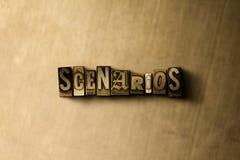 ENCENAÇÕES - close-up vintage sujo da palavra typeset no contexto do metal Imagens de Stock Royalty Free