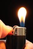 Encendedor del fuego en la mano Imágenes de archivo libres de regalías