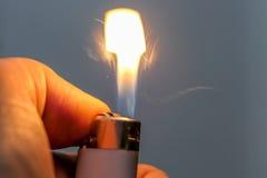 Encendedor después de encender fotos de archivo