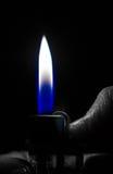 Encendedor en la mano blanco y negro Foto de archivo libre de regalías