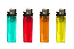 Encendedores coloreados aislados Foto de archivo libre de regalías