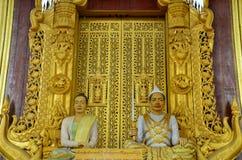 Encere el rey y a la reina simulados modelo en el palacio de Mandalay Foto de archivo libre de regalías