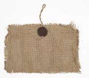 Encere el sello en el material de la harpillera Fotos de archivo
