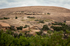 Enchant Rock View. A view of the granite dome, called Enchanted Rock, at Enchanted Rock State Park outside of Fredericksburg, Texas. In the heart of the Hill Royalty Free Stock Photo