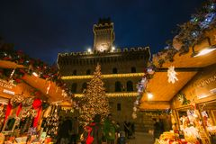 Enchanted atmosphere in the beautiful square of Montepulciano with Christmas market and tree. Italy stock photography