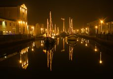 Enchanted atmosphere at night in the historic center of Cesenatico with christmas nativity scene in the boats Royalty Free Stock Image