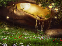 Enchanted cave with flowers. Lanterns and butterflies Stock Images