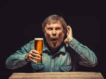 The enchanted and emotional fan with glass of beer Royalty Free Stock Image