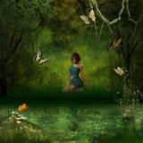 Enchanted forest. A beautiful lady is sitting on the edge of a river looking at her reflection Stock Images